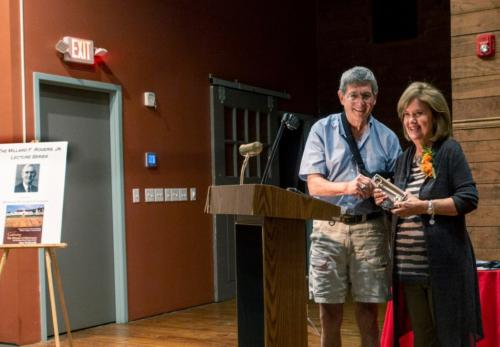 Mayor Dan Policastro presents Jane McDonald with the key to the Village